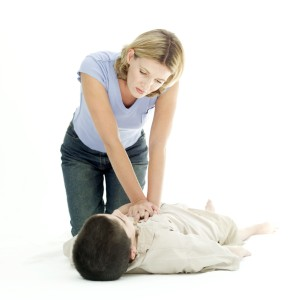 Woman Resuscitating a Young Boy