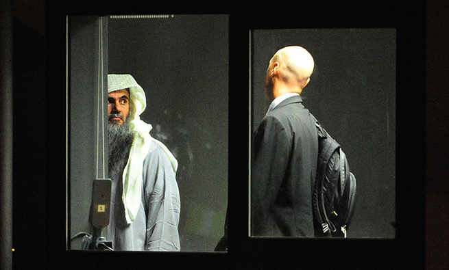 Muslim cleric Abu Qatada prepares to board a small aircraft bound for Jorda